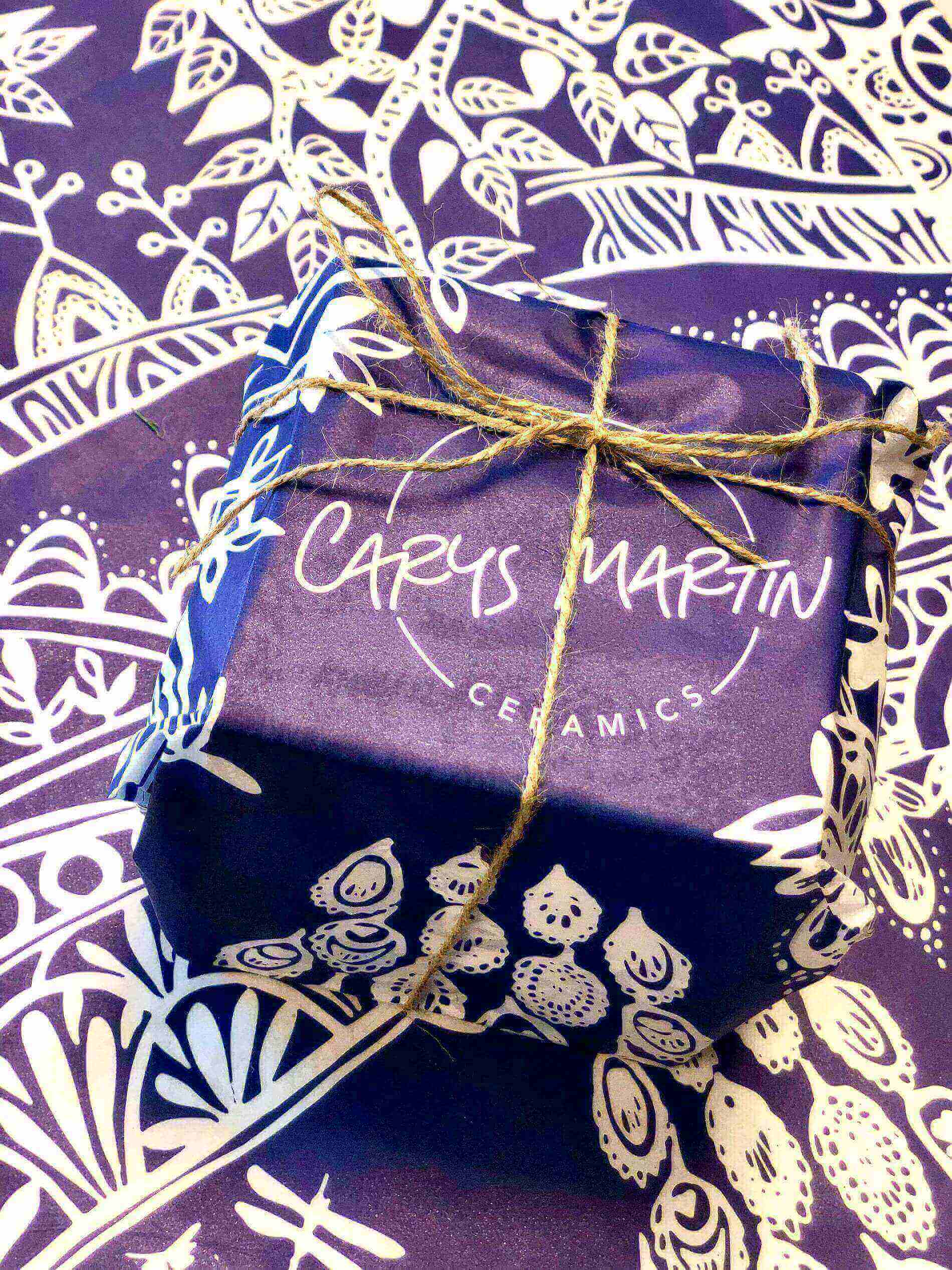 Package wrapped up in Carys Martin Ceramics branded tissue paper