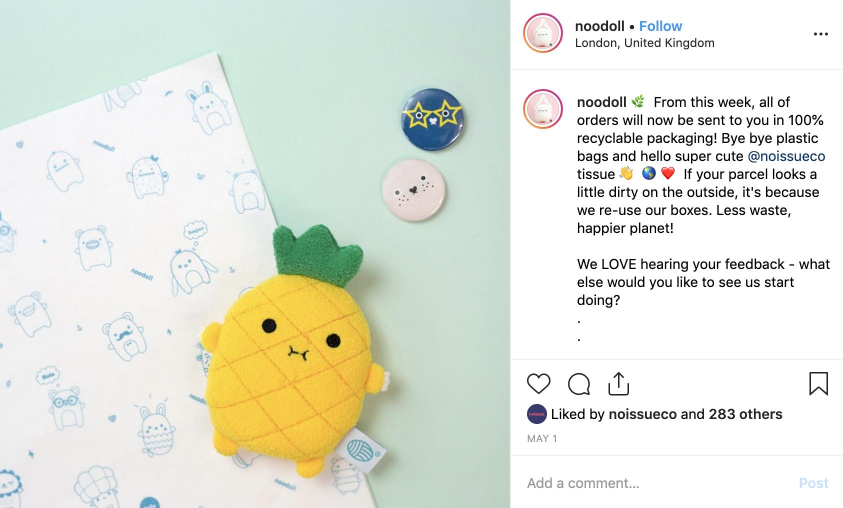 Noodoll toy lying on custom tissue paper