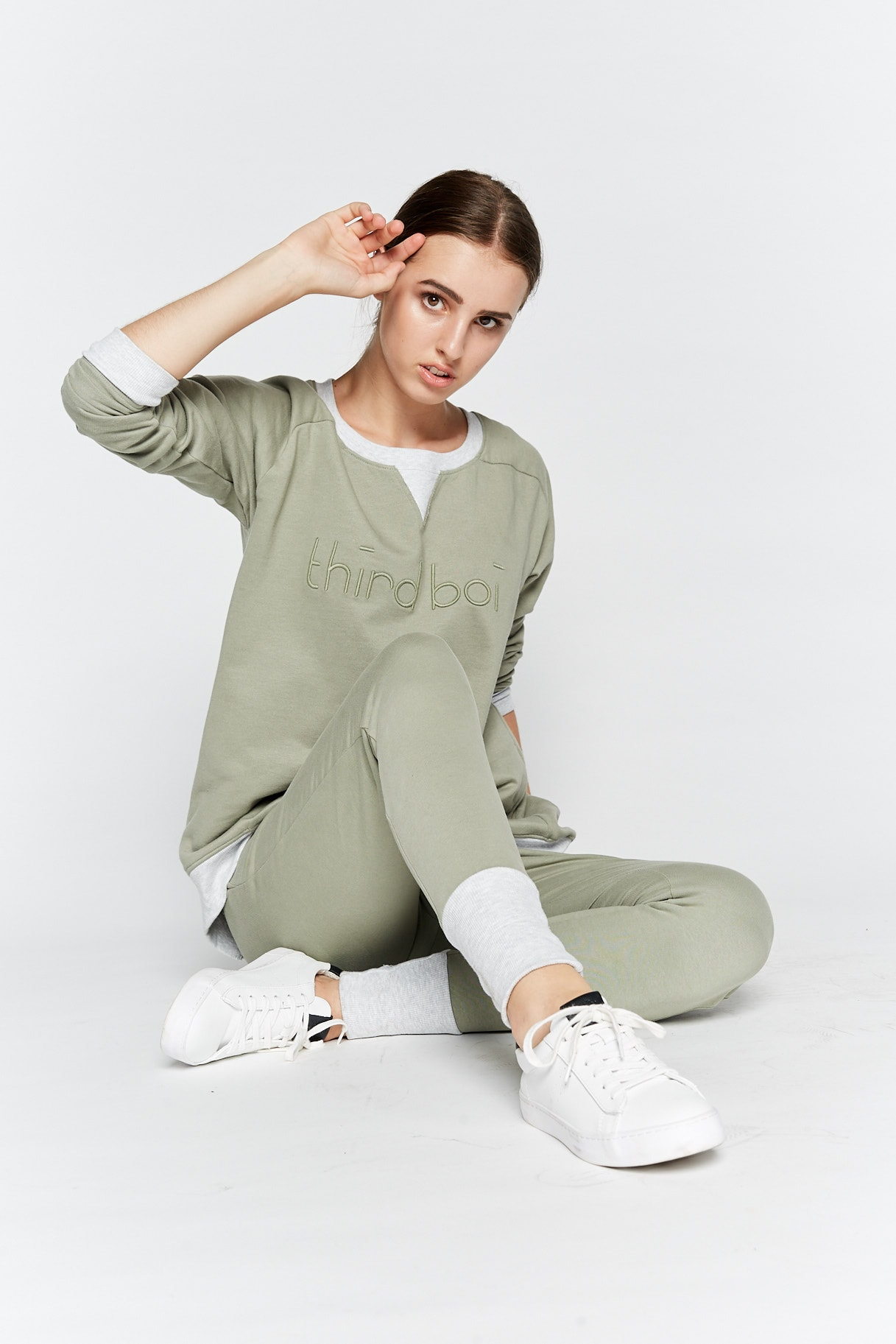 Model wearing Third Boi sweater and leggings