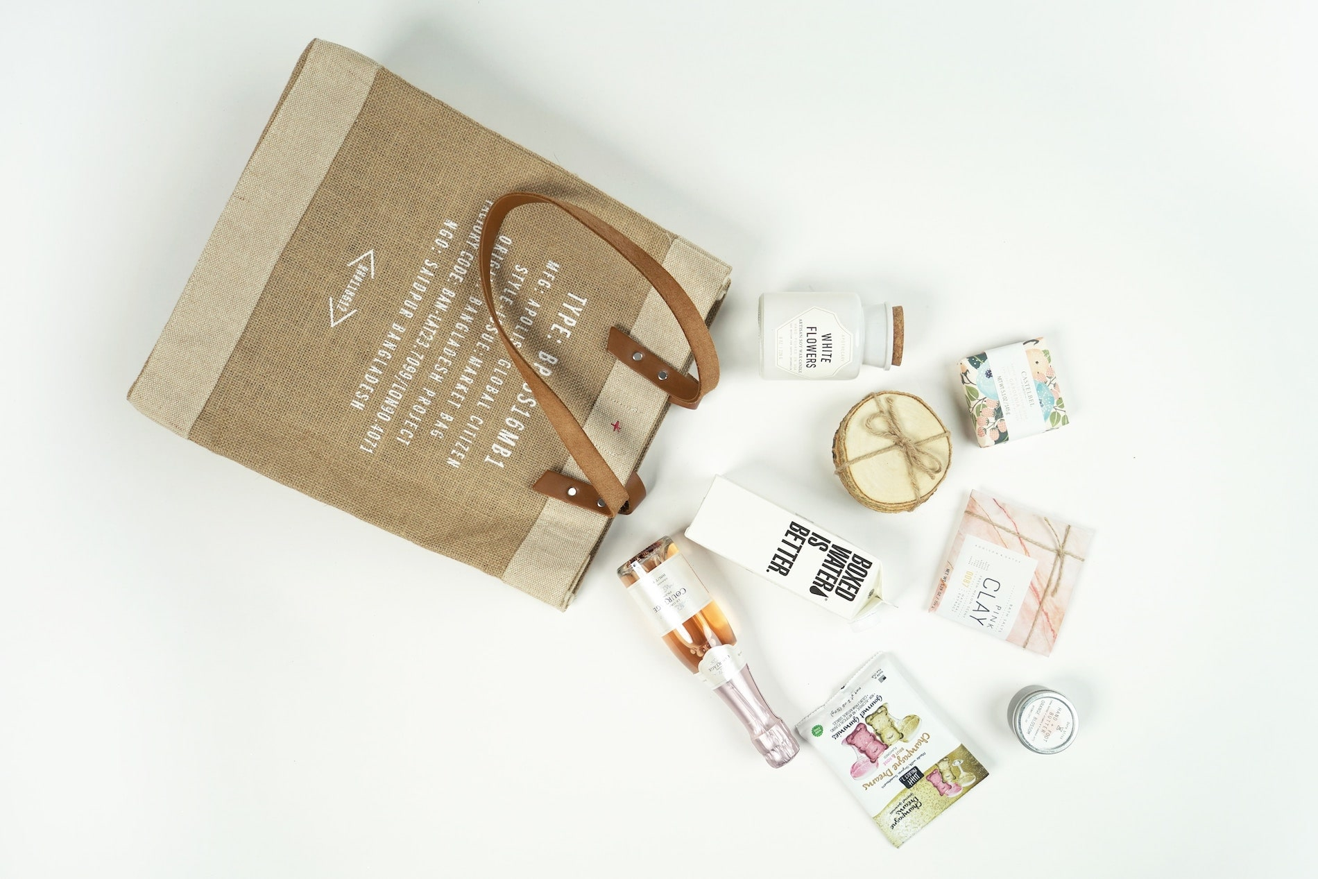 Jute shopping bag with products spilling out