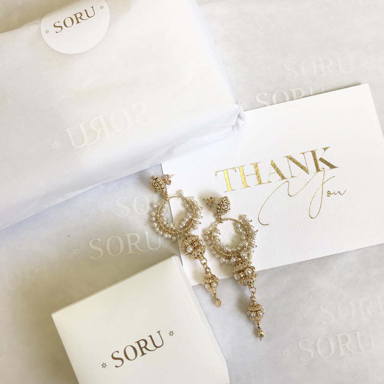 Soru Jewellery flatlay with custom tissue paper
