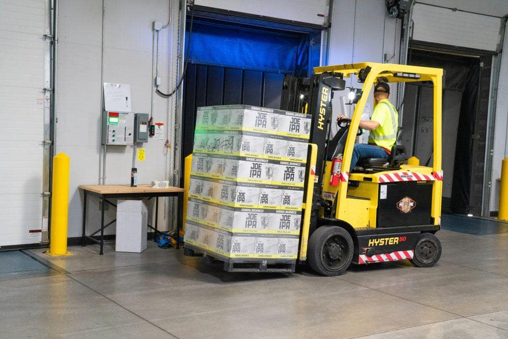 Warehouse with forklift truck moving pallets around